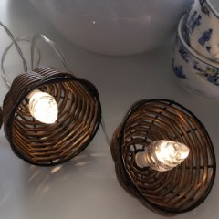 Light chain with hoods made of rattan